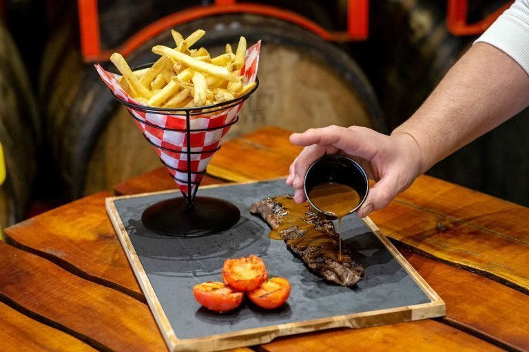 fries and meat on chalkboard