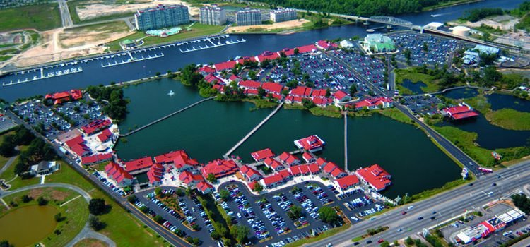 Rendering of aerial view of Barefoot Landing showing busineses, homes, and waterways